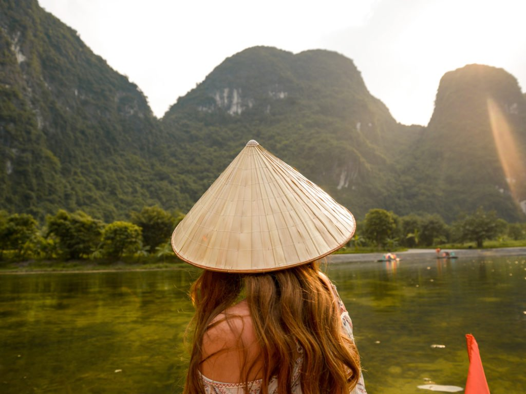 Me as I visit Vietnam and explore Trang An by boat