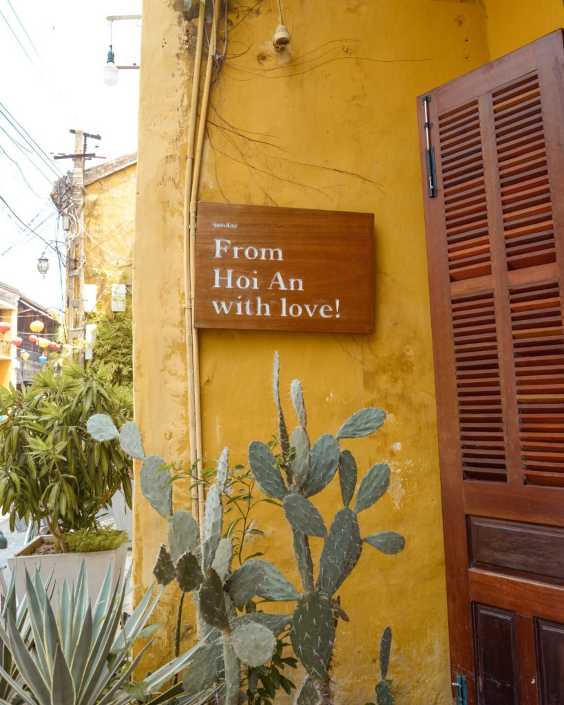 plants in front of yellow wall with text 'from Hoi An with love!'