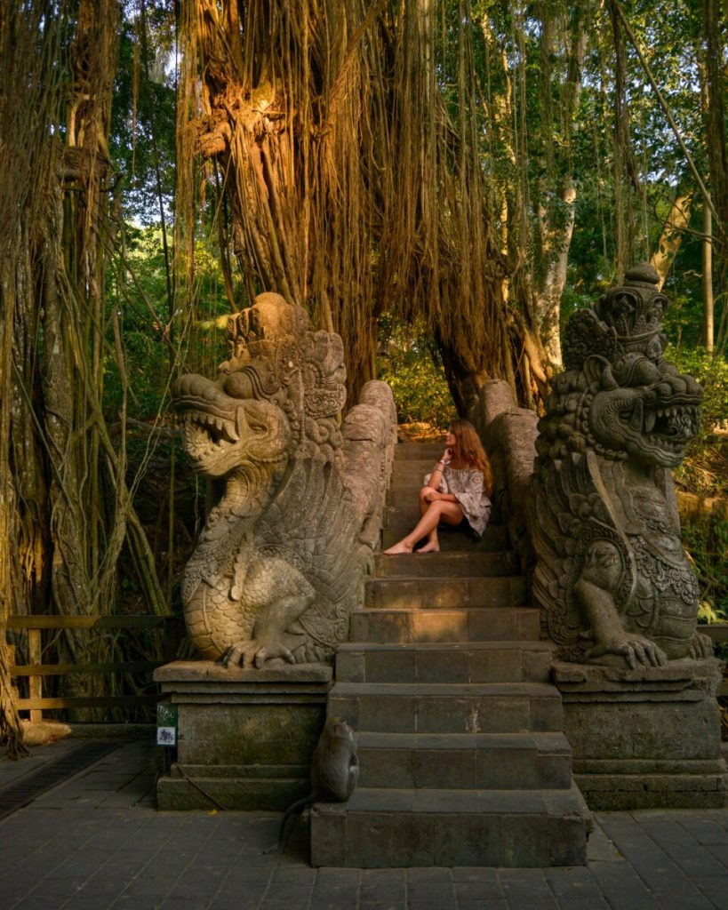 Woman sitting on staircase at Monkey Forest in Bali, Indonesia