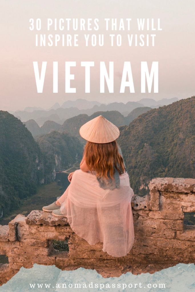 Hang Mua Caves Viewpoint Vietnam; Girl with hat sitting on wall