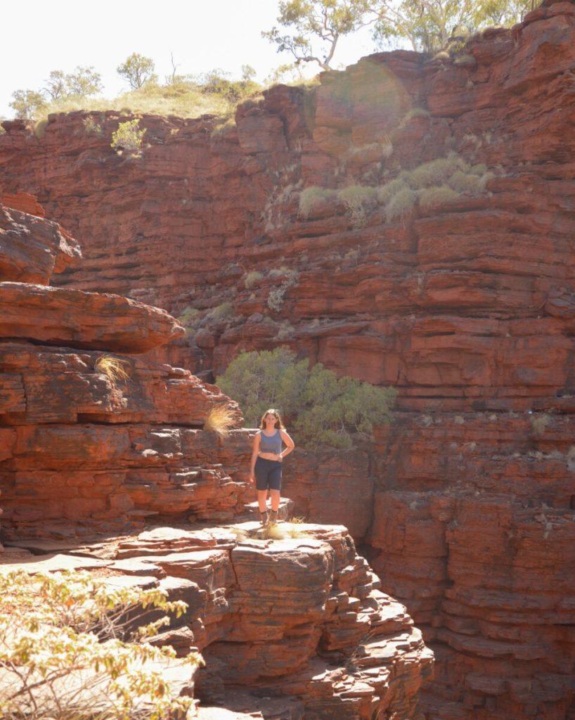 Hiker standing close to cliff in Western Australia Joffrey Gorge