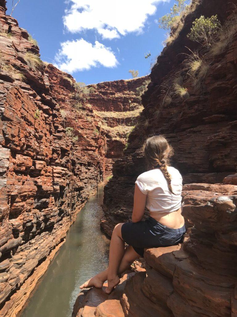 Woman sitting in gorge in Karijini