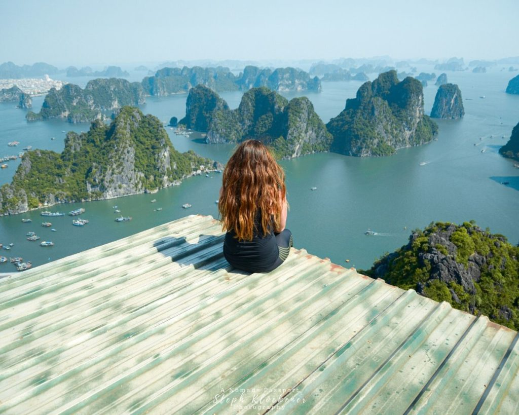 Girl looking over Ha Long Bay Limestone Islands in Vietnam which is in Asia.