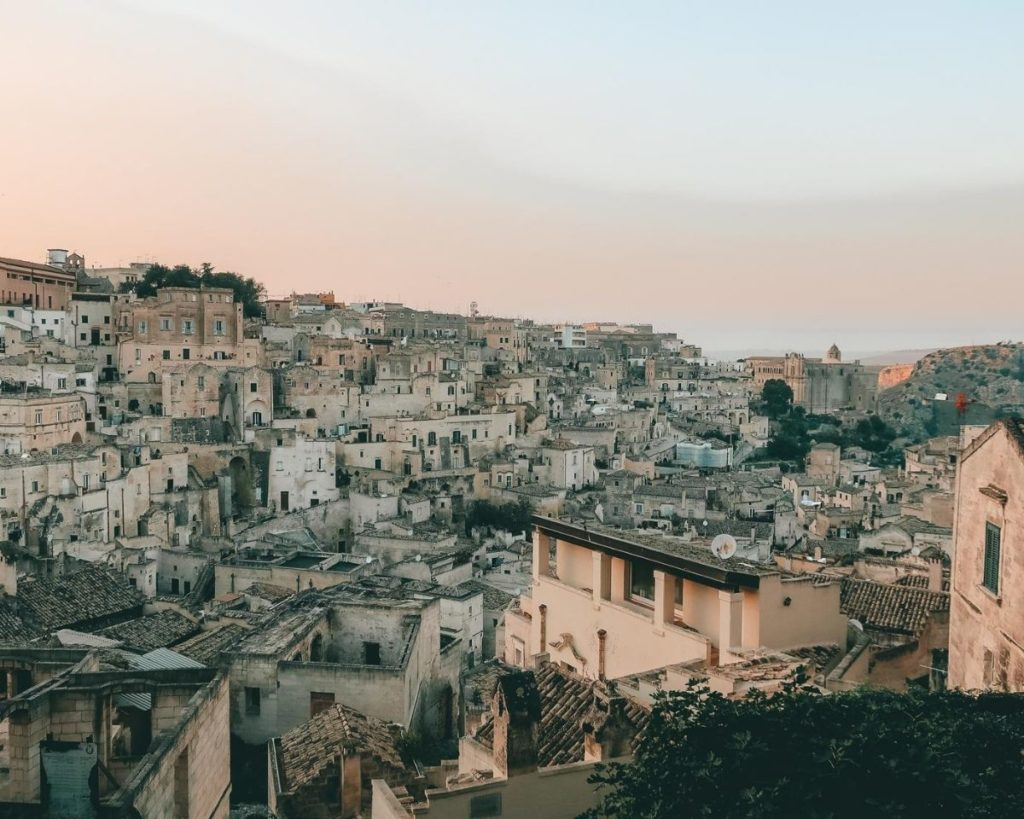 Sunset over houses in Matera which in one of the best budget-friendly weekend getaways in Italy