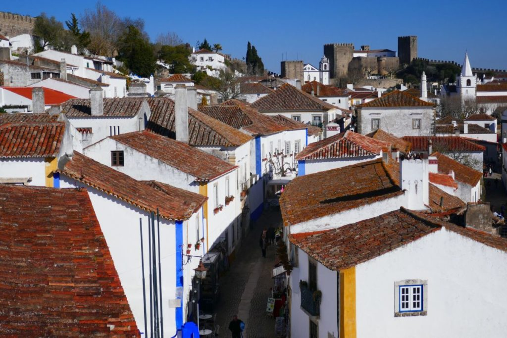 White houses in Óbidos which you will see during one of the best weekend trips in Portugal
