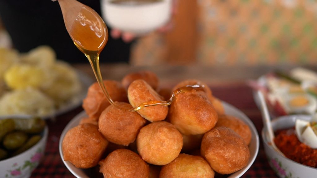 Traditional Montenegrin priganicas with honey, which are one of the favorite dishes along the gastro-route Mountain Bounty.