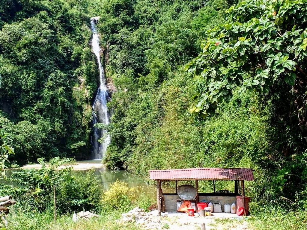 Waterfall surrounded by greenery close to Xin Man