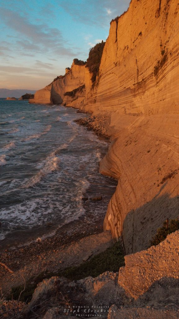 Sunset-painted cliffs at Logas Beach, Corfu